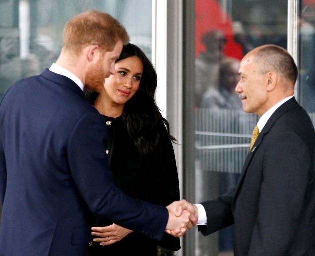 "Prince Harry and Meghan, the Duchess of Sussex, with NZ""s High Commissioner to London Sir Jerry..."