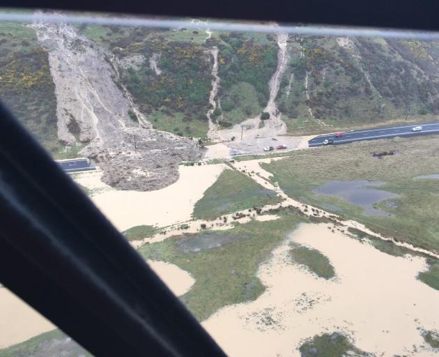 A massive slip on Harington Point Rd, near Harwood, on Saturday. Photo: Dunedin Civil Defence...