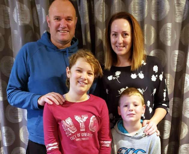 Former Dunedin man Craig Hickford, pictured with wife Stacey and children Grace and Toby, in...