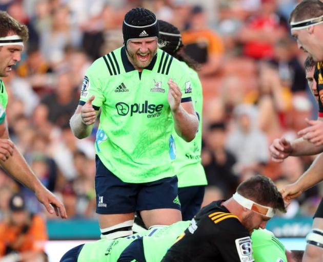 Josh Dickson applauds a try against the Chiefs. Photo: Getty Images