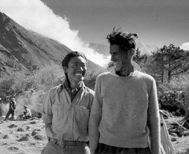 Tenzing Norgay and Ed Hillary relax after conquering Everest. Photo: Rupert Taylor-Price