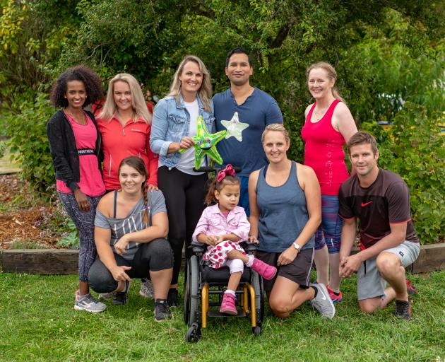 Stephanie and James Emery (back, centre) have been joined by a group of Kaiapoi mothers in ...