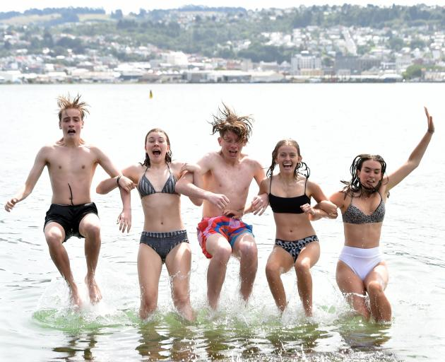 Cooling down at Vauxhall from left, Jack Murphy (16) Niamh Crooks (15) Sam Sinclair (15) Sophie Broadley (16) and Elsha Bulmer (16) all of Dunedin on a hot Dunedin day at Macandrew Bay on Tuesday evening.PHOTO:PETER MCINTOSH