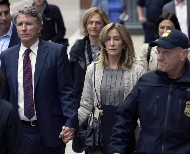 Felicity Huffman (centre) with brother Moore Huffman Jr on Monday. Photo: AP