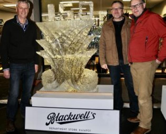 Andrew Blackwell, left, Greg Comfort and Maarten Loeffen beside the finished tribute. Photo:...