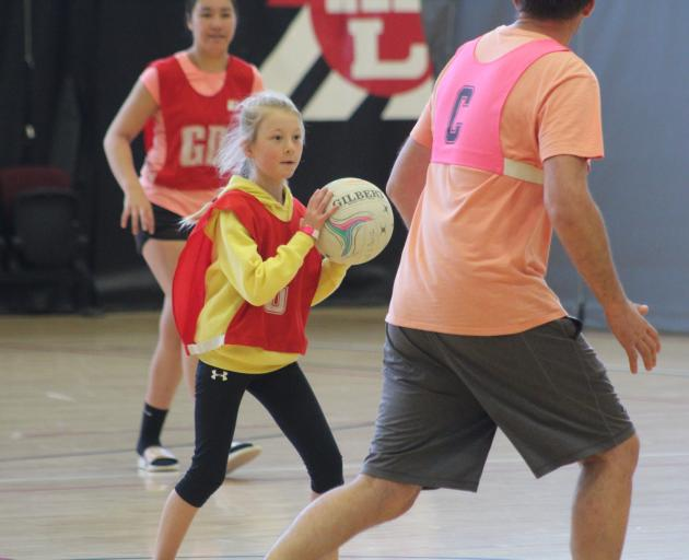 Evie Lester (9), of Invercargill, gets stuck in to a game on the public court at the 12-hour...