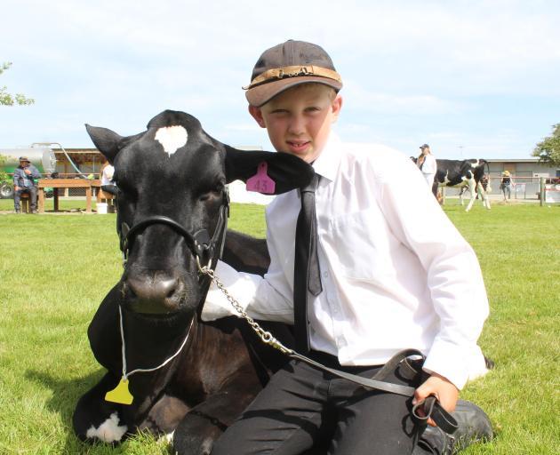 Jake Eden, of Balfour, with Holstein Friesian Becky.