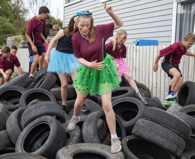 Lily Goodall, of Casebrook Intermediate School, negotiates the Tyre Temple obstacle. Photo: Geoff...