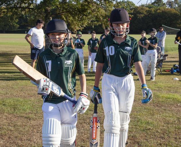 Ciara Hartland and team captain Isla Cameron walk out to open the batting. Photo: Geoff Sloan