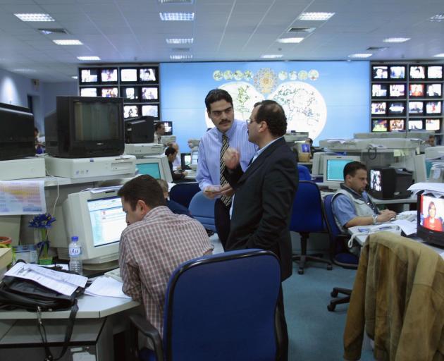 The Al Jazeera newsroom. Photo: Christophe Calais / Corbis via Getty Images
