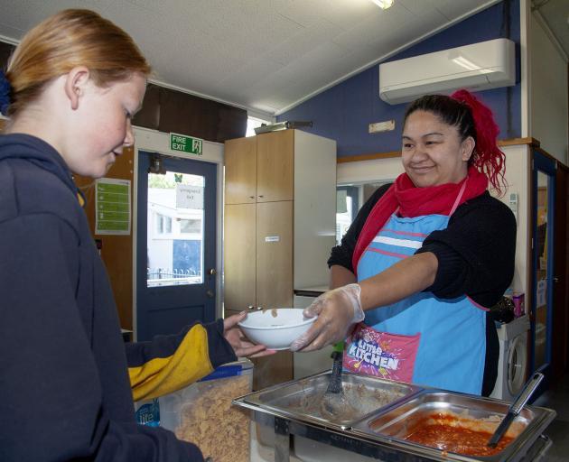 Year 6 pupil Sarah Wilson and Breakfast Club co-founder Charlotte Clark. Photo: Geoff Sloan
