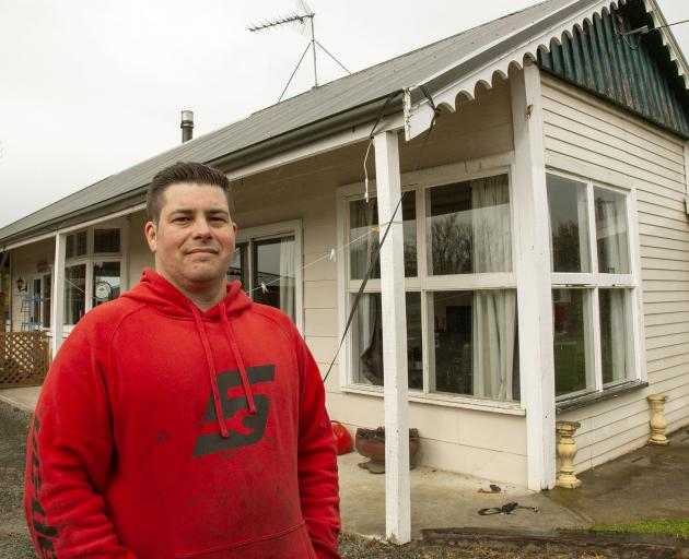 Sam Adkins ran outside to secure his home's roof when he heard it flapping up and down about 5am....