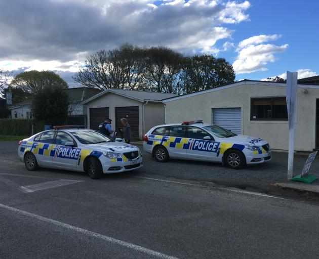 Police at the Kakanui Store on High St this afternoon. Photo: Daniel Birchfield