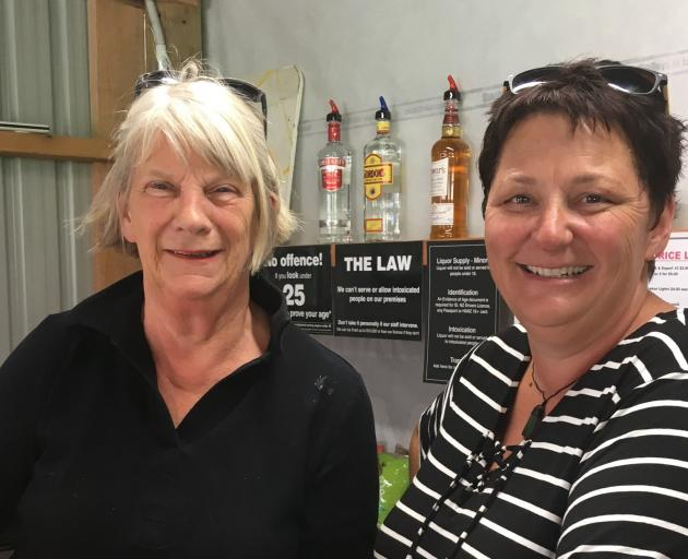 Sylvia Anderson (left) and Prue O'Neill in the bar at the Omarama sheep dog trials. PHOTO: SALLY...