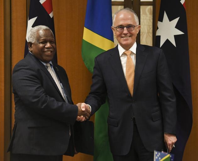 Prime Minister of the Solomon Islands Rick Houenipwela (left) and Australian Prime Minister...