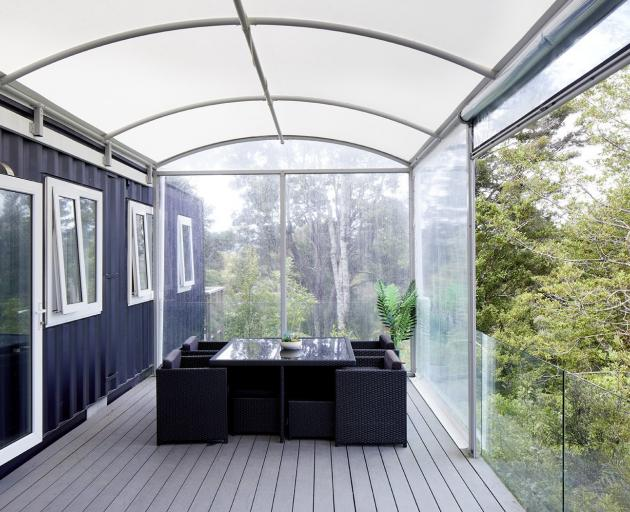 A covered deck completes the rectangle created by the two containers and nearly doubles the...