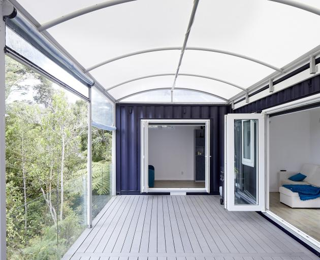 The covered deck allows the two containers to operate as a single living space.