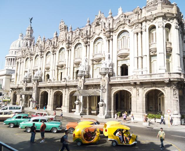 The Hotel Inglaterra, Havana's famous historic hotel, located near the National Theatre and the Capitol. Special taxis are available outside to take tourists through the narrow alleys of Old Havana.PHOTO: GETTY IMAGES