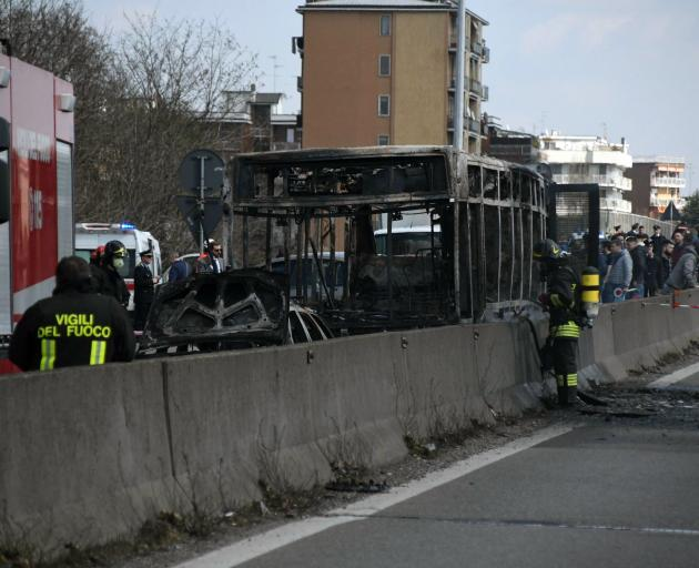 Police managed to get all passengers out safely after the bus was set on fire. Photo: AP