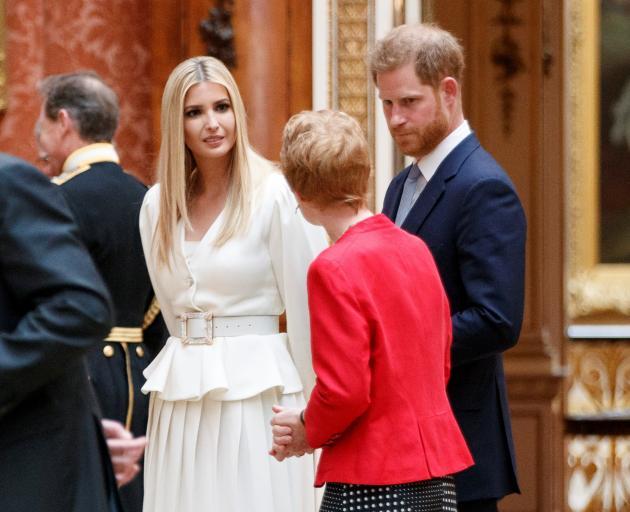 Ivanka Trump (left) with Prince Harry. Photo: Reuters