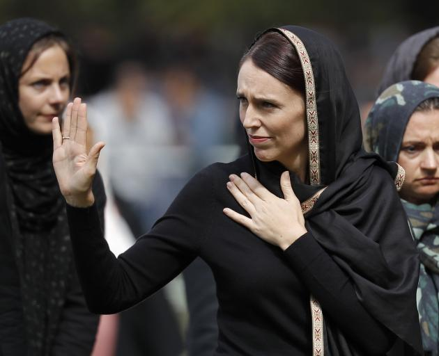 Wearing a hijab in support of the Muslim community, Jacinda Ardern acknowledges the crowd...