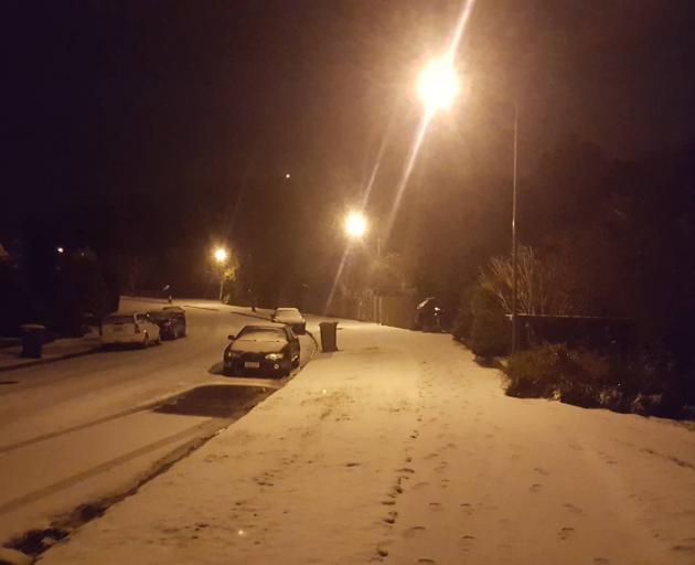 Snow blankets Glenross St in Dunedin. Photo: James Hall