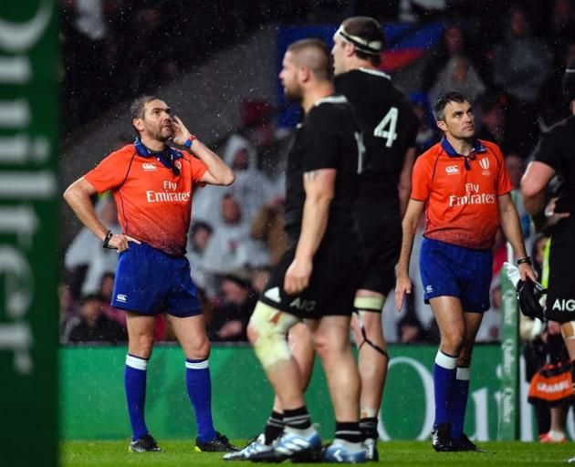 Referee Jerome Garces (left) and Marius Mitrea wait on the TMO decision. Photo: Ashley Western/MB...
