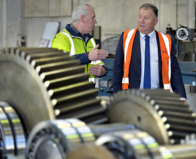 Explaining the ins and outs of the work at Farra Enginnering's workshop to the Regional Economic Development Minister Shane Jones is the company's heavy engineering manager Mike Ryan. Photo: Gerard O'Brien