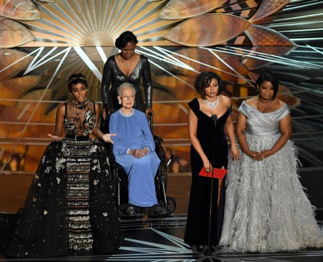 NASA mathematician Katherine Johnson (seated) appears onstage with (L-R at front) actors Janelle Monae, Taraji P. Henson and Octavia Spencer speak onstage during the 89th Annual Academy Awards. Photo: Getty Images