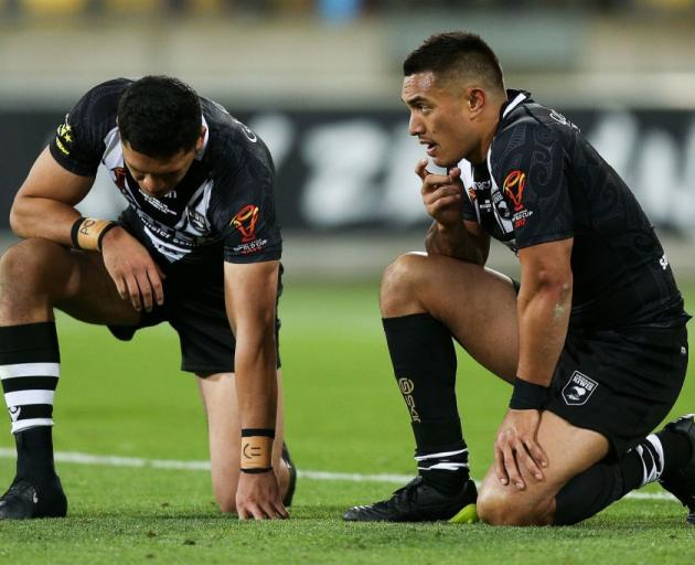 Kiwis backs Dallin Watene Zelezniak and Dean Whare react after losing to Fiji in their Rugby...