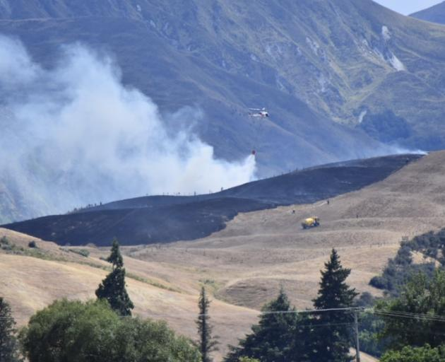 Three helicopters were called in to help fight the blaze. Photo: Becki Bentley