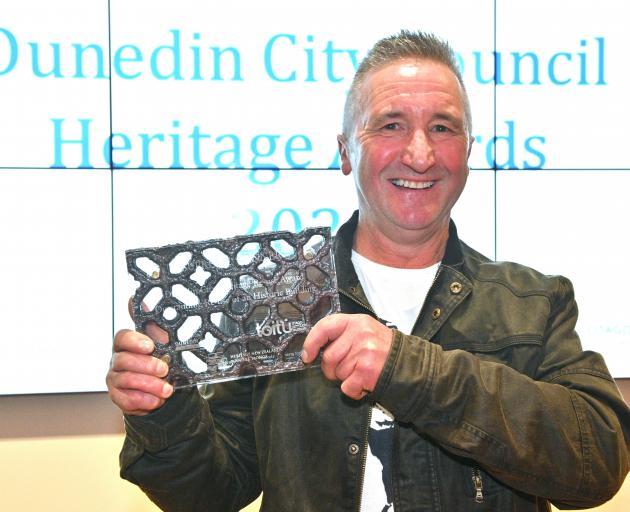 Lawrie Forbes receives the top award at the Dunedin Heritage Awards last night. PHOTO: LINDA...