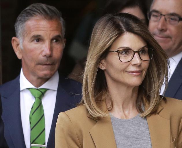 Lori Loughli and husband Mossimo Giannulli (left). Photo: AP