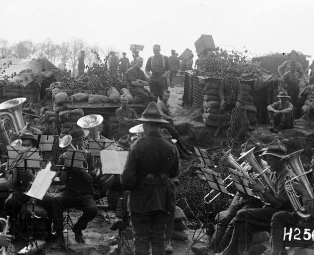 An NZEF military band playing close to the line near Ypres, France in 1917. Photo: Alexander Turnbull Library