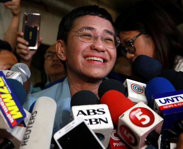 Maria Ressa talks to media after being bailed in Manila. Photo: Reuters