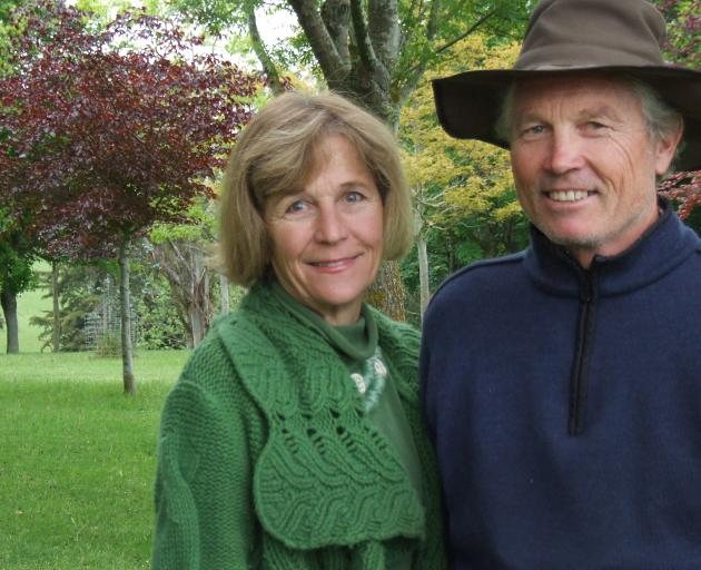 Marjorie and Mark Hay in front of a woodland area planted 24 years ago. Photos: Sally Rae