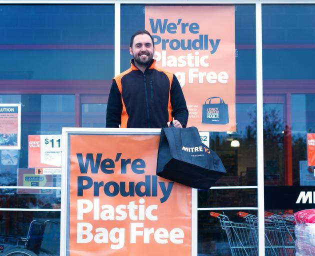 Matt Gallaher, marketing manager, Mitre 10 Wanaka, outside one of their stores which no longer...
