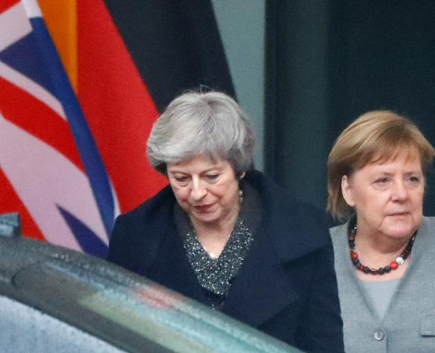 Theresa May (left) with Angela Merkel in Berlin. Photo: Reuters