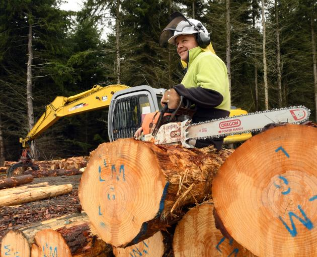 Scott  McKenzie with his tools of his trade at his logging skidder site.
