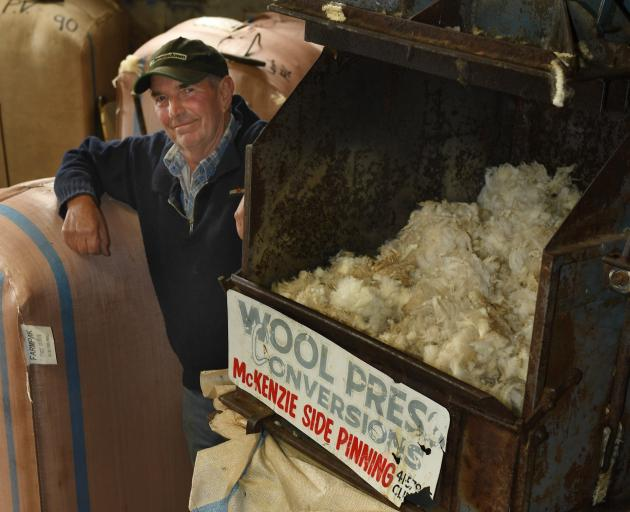 Colin  McKenzie with one of his early pinned wool presses. He  invented the McKenzie side-pinning...