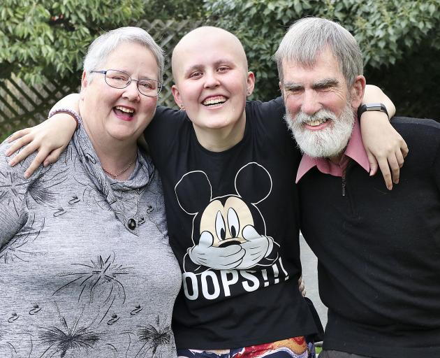 Megan with her mother Marilyn and father Richard. Photo: Martin Hunter