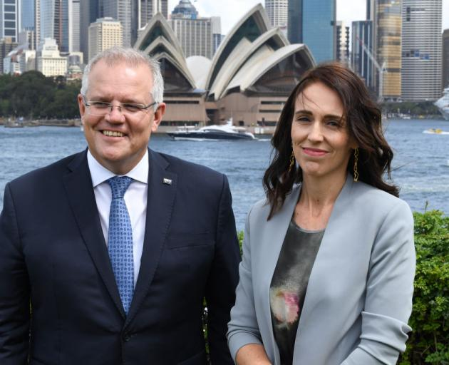 Scott Morrison  and Jacinda Ardern in February. Photo: Getty Images