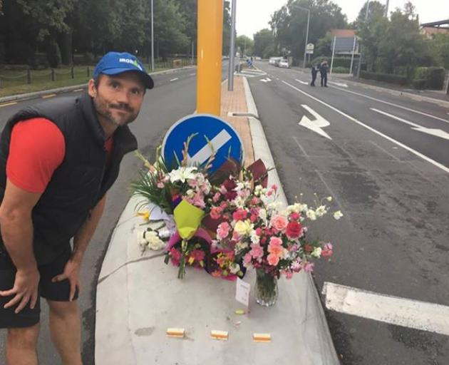 Aaron Nash left flowers for those killed in the mosques. Photo: George Block