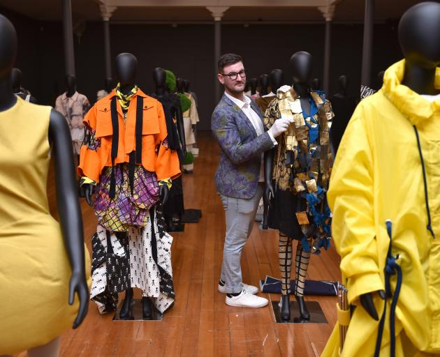 Otago Museum curator Craig Scott puts some finishing touches on the ''Fashion FWD'' exhibits....
