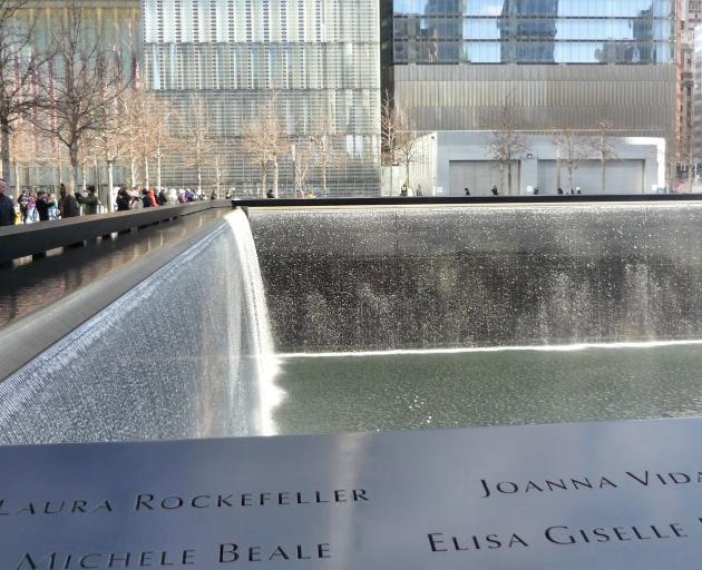 Names of those who died in the terror attacks line the memorial pools near One World Trade Centre and giant walls of water pour down the sides and into a black hole in the centre to be recycled. PHOTO: HELEN SPEIRS