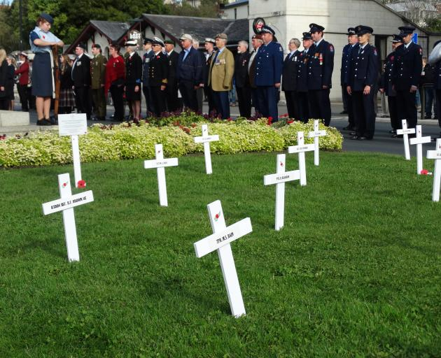 A parade in lower Thames St stops to pay its respects at Oamaru's World War One memorial. PHOTO:...