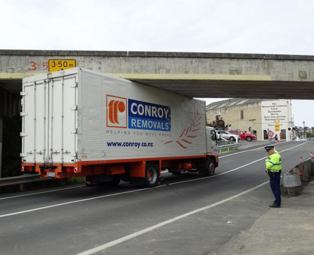 The truck became wedged about 10.15am today. Photo: Daniel Birchfield