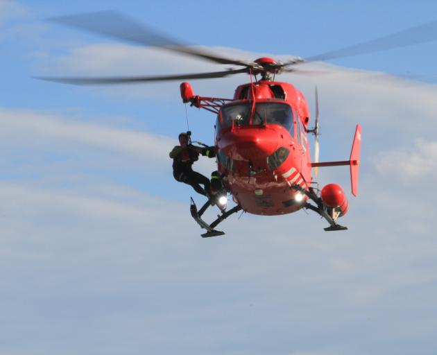 An Otago Rescue Helicopter crew member is hoisted back on board after leaving the water during a...