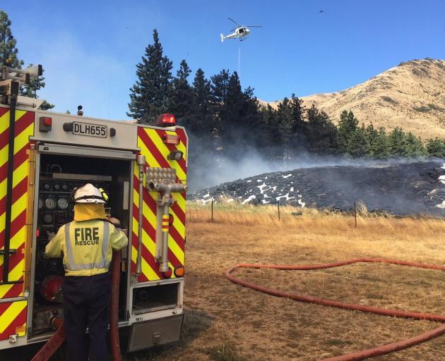 Fire crews battle a large hay-bale fire in Broken Hut Rd, near Omarama, yesterday. PHOTO: SUPPLIED