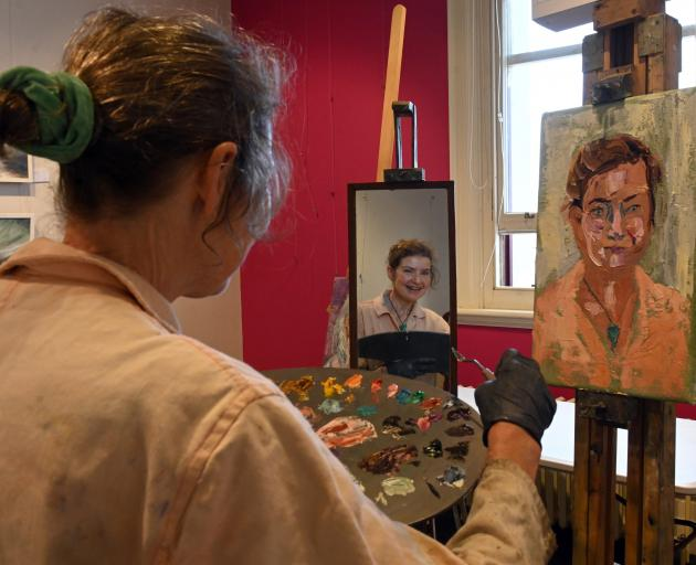 Dunedin artist Jude Ansbacher paints from her reflection in a mirror using oils and an impasto...